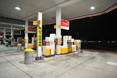 Gas station. Empty Shell gas station by night royalty free stock image