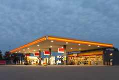 Gas station. With shop at evening royalty free stock photos