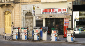 Gas station. An old working gas station in a Maltese city on the curb of the street. Not a typical gas station Stock Photos