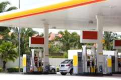 Gas Station. Image of a gas station with cars being refulled royalty free stock photo