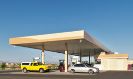 Gas Station. Car and pick up truck filling up at gas staton stock image
