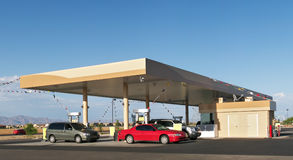 Gas Station. Car and mini van filling up at gas staton stock photos