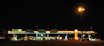 Gas station with cars inside. Shell gas station with cars in night near highway royalty free stock images
