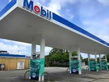 Gas station closed for Hurricane Irma. FORT LAUDERDALE, FL - SEPTEMBER 8, 2017: Mobil Gas Station shrink wraps their pumps after running out of gas as customers Stock Images