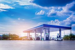 Gas station with clouds and blue sky fotos de archivo
