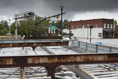 Gas station cover that has collaped during Hurricane Florence. Gas station roof that has flipped in Raeford North Carolina during Hurricane Florence stock photos