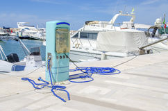 Gas station harbor power supply marina blue pump pier white Stock Images