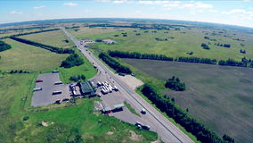The gas station, hotel and road service. Aerial view of a highway with cars driving along a road. stock footage