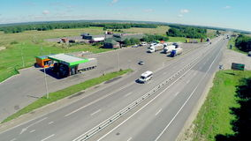 The gas station, hotel and road service. Aerial view of a highway with cars driving along a road. stock video