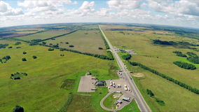 The gas station, hotel and road service. Aerial view of a highway with cars driving along a road. stock video footage