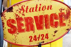 Gas station 24 hour retro vintage sign france stock image