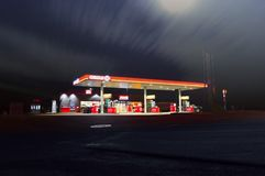 Gas station illuminated at night Royalty Free Stock Image