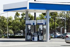 Gas Station Island Of Pumps With Street And Cars Stock Photography