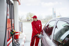 At Gas Station. Male Worker At Gas Station Filling Up Customers Car With Petrol Royalty Free Stock Photo