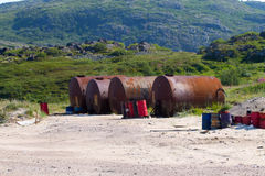 Gas station in mountains i Arctic with barrels Royalty Free Stock Photography