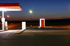 Gas Station at Night. Brightly lit, deserted Stock Images