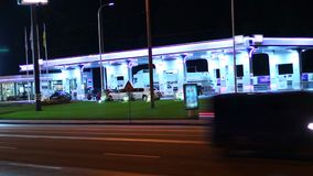 Gas station at night, contemporary petrol service cars drive in. Stock footage stock video
