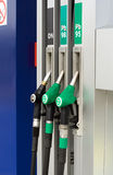 Gas station nozzles Stock Photography