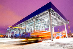 Gas station at oil refinery factory night time Stock Images