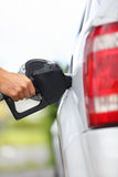 Gas station pump - filling gasoline in car Royalty Free Stock Image