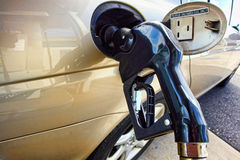 Gas Station Pump Nozzle in Car Tank Filling Intake stock photos