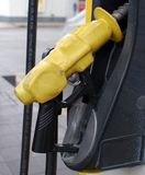 Gas Station Pump Nozzle. To fill up with premium unleaded gasoline Stock Image