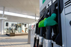 Gas station. Pump nozzles at the gas station stock images