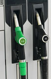 Gas station. Pump nozzles in gas station Royalty Free Stock Image