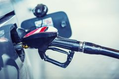 Gas station. Pumping the fuel diesel or petrol on gas station Royalty Free Stock Images