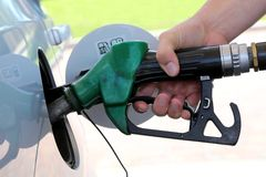 Gas Station Refill Hand and Nozzle Royalty Free Stock Photos