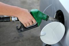 Gas Station Refill Hand and Nozzle Royalty Free Stock Photo