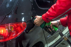 Gas station. Sao Paulo, Brazil, November 15, 2011. detail of a car being fueled with ethanol in a gas station in Sao Paulo Stock Images