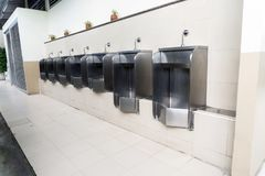 Gas station stainless toilet. urinals men in gas station. Toilet Stock Photo