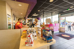 Gas station store interior. In France.Customers are paying at the cash register inside a gas station shop. Photo taken on: Septembre 12, 2015 stock photos