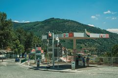 Gas station on street and hilly landscape. Manteigas, Portugal - July 14, 2018. Gas station on street and hilly landscape covered by trees in Manteigas. It is royalty free stock images