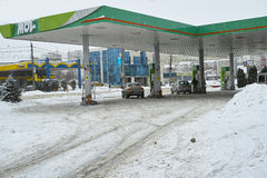Gas station in winter time Stock Images