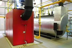 Gas steam boilers. Interior independent modern gas boiler-heating royalty free stock photo