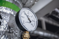 Gas or steam leaking from an industrial pressure gauge. Stock Images