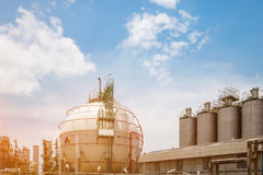 Gas storage. Spheres tank in oil refinery plant on blue sky with white cloud background Stock Images