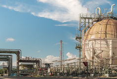 Gas storage. Tank in oil refinery plant on blue sky background Royalty Free Stock Photography