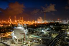 Oil and gas refinery. Gas storage sphere tanks and pipeline in oil and gas refinery industrial plant with glitter lighting industry estate at night stock image
