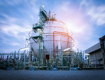 Gas Storage Spheres Tank In Oil Refinery Plant On Sky Sunrise Royalty Free Stock Photography