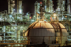 Gas storage spheres tank. Oil and gas storage spheres tank in oil refinery industrial at night, Petrochemical plant and lighting at nighttime Stock Image