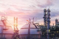 Gas storage spheres tank in oil refinery plant. On sky sunset background Royalty Free Stock Image