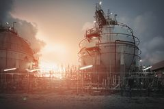 Gas storage. Spheres tank in oil refinery plant on sky sunrise background Royalty Free Stock Photos