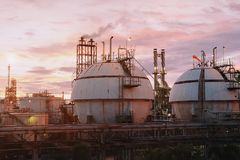 Gas storage spheres tank in petrochemical plant. On sky sunset background Stock Images