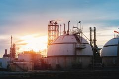 Gas storage sunset. Gas storage spheres tank in oil refinery industry on sky sunset Royalty Free Stock Photography