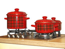 Gas-stove. The gas-stove with saucepans set Stock Photos