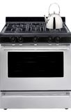 Gas stove. Gray gas stove with a kettle isolated on a white background royalty free stock photo