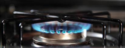 Gas stove. Detail shot of the blue gas flame of a gas stove Stock Photography